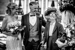 Grandmother with bride and groom