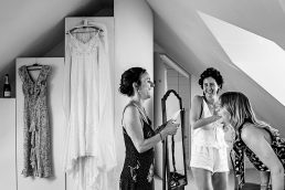 Bridesmaids and bride in the morning laughing in London