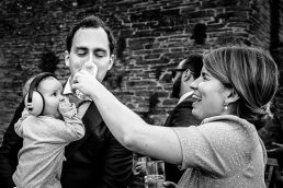 Baby at the wedding wanting a drink